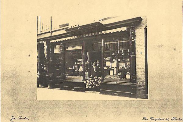 Photo Mr Van der Geest in front of his shop